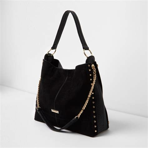 river island synthetic black studded oversized slouch chain bag lyst