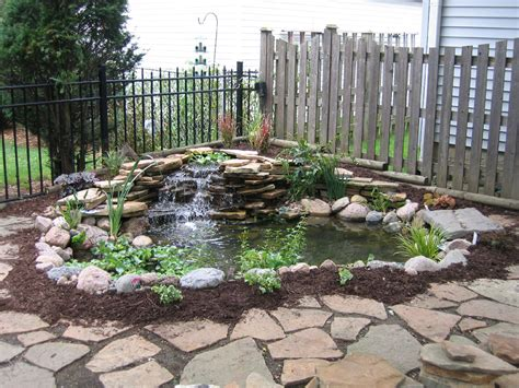 easy and simple backyard landscaping house design with ponds surrounded by small garden with