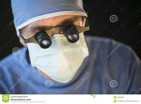glasses magnifying mask surgeon wearing close male against background doctor scope dreamstime surgeries ibm adriana eng cancer tech safety lang