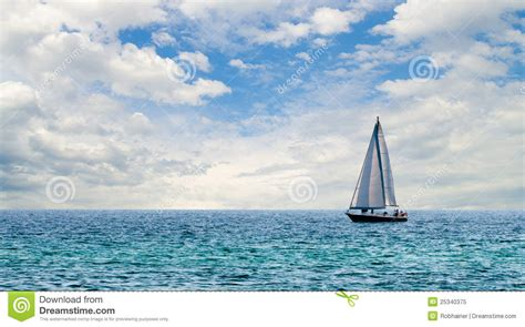 Sailboat On Water by Sailboat On Light Blue Water Florida Gulf Royalty Free