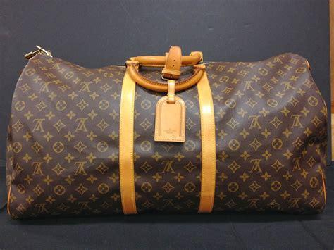 antiques art  collectibles louis vuitton keepall bandouliere  duffel bag
