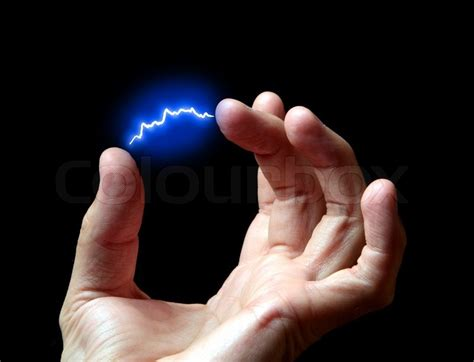 electric discharge in a hand against a dark background