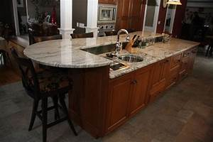 Custom kitchen island cabinets with seating in wilbraham for Some tips for custom kitchen island ideas
