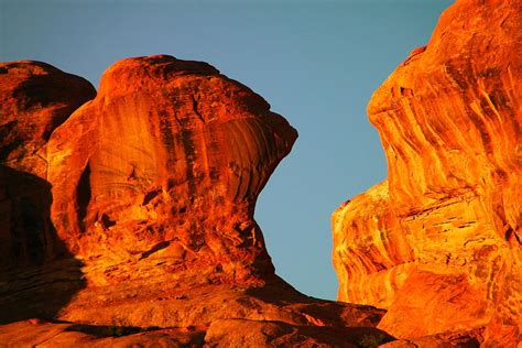 orange rock foreground a blue sky photograph by jeff swan