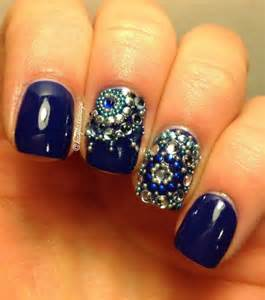 Dark blue nails with rhinestone nail art for the