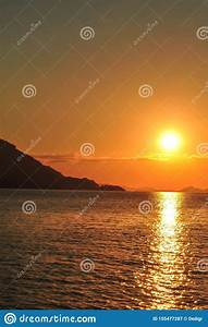 Bright, Sunset, With, Large, Yellow, Sun, Under, The, Sea, Surface