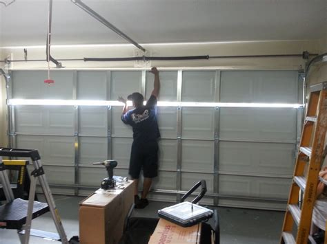 How To Put On Garage Door by How To Install Garage Door By Yourself Theydesign Net