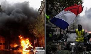 Chaos in Paris as protesters battle riot police, over 200 ...