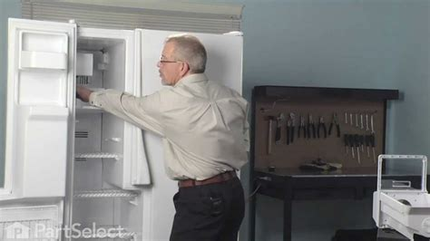 refrigerator repair replacing  ice maker assembly whirlpool part dq youtube