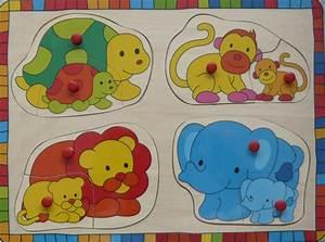 Puzzle En Bois Bébé : toys 610625d puzzle 8 pi ces bouton animaux sauvages ~ Dode.kayakingforconservation.com Idées de Décoration