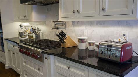 kitchen backsplash with black granite black pearl granite countertops with white cabinets 7712