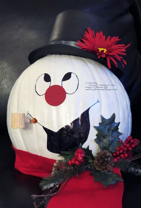 pumpkins decorated for christmas pumpkins and snowman on