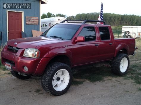lifted nissan frontier white 2001 nissan frontier rev 811 beast custom suspension lift