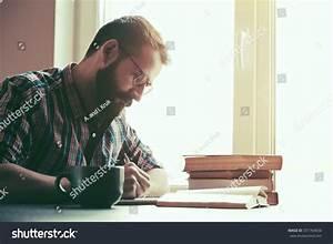 Bearded Man Writing Pen Reading Books Stock Photo ...