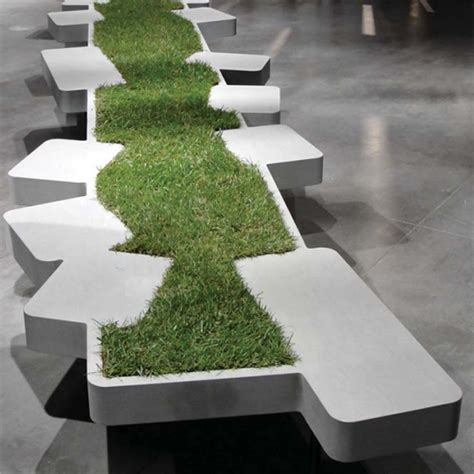 Outdoor Cement Bench by Urban Seating Unit Adorned By Miniature Grass Island