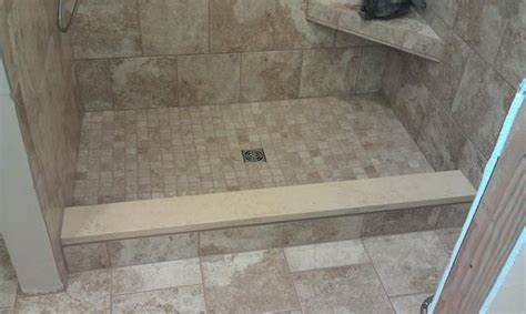 marble threshold for shower capping shower curb with the same quartz being used on the