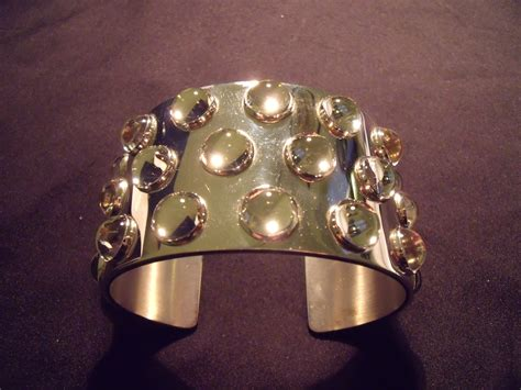 Crystal Carpets by Lalique Silver Bangle Mossi Angry Agent