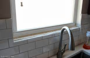 installing subway tile backsplash in kitchen duo ventures kitchen update paint touch ups window sill