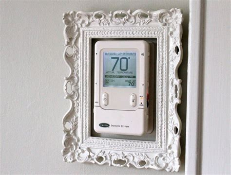 In the world of home decor, mirrors can be a magical design tool, but they also have their downsides. Frame your Thermostat | Decor, Frame, Home accessories