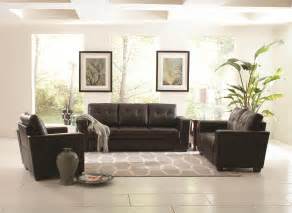 black leather couch plus white gray rug on the white tile