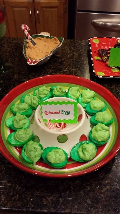 Are you out of ideas of gifts for a one year old? Grinched eggs for whoville theme Christmas Dinner | Christmas dinner themes, Christmas recipes ...