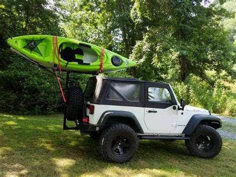 jeep kayak rack jeep 35 quot tires hitchmount rack and two kayaks mission
