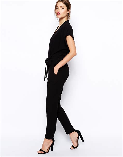 black jumpsuit with sleeves asos jumpsuit with tie waist and sleeves in black lyst