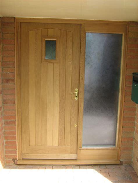 oak front door  merrin joinery  brass door handle