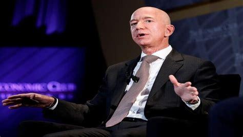 Amazon's Bezos challenges retail rivals to raise minimum ...