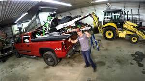 truckboss loading a snowmobile on the sled deck youtube