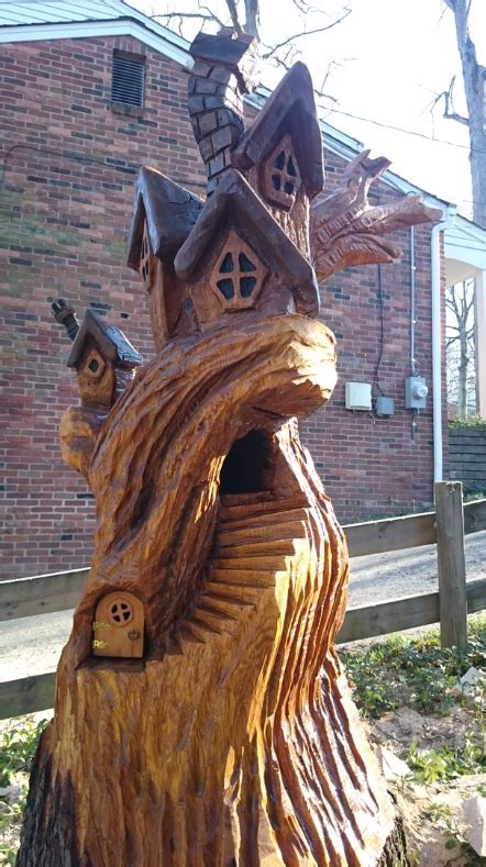 chainsaw carving  paul treehouses