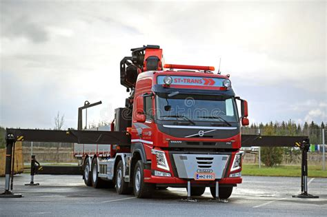 red volvo truck red volvo fm truck equipped with heavy crane editorial