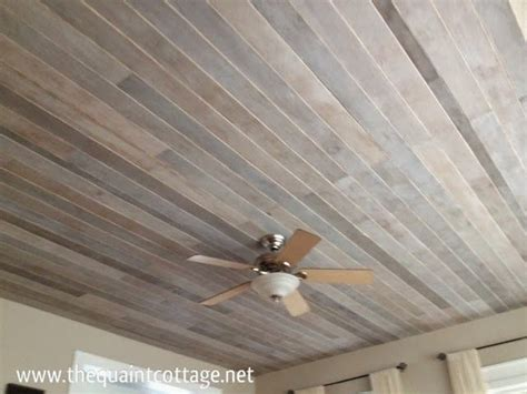 vinyl plank flooring on ceiling diy faux rustic plank ceiling via the quaint cottage your funky junk a repurposing