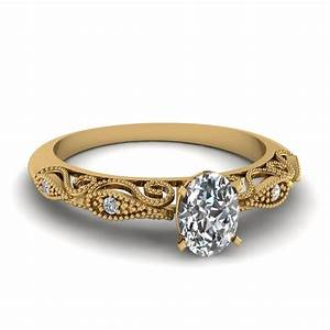 oval shaped paisley diamond ring in 18k yellow gold With oval diamond wedding rings