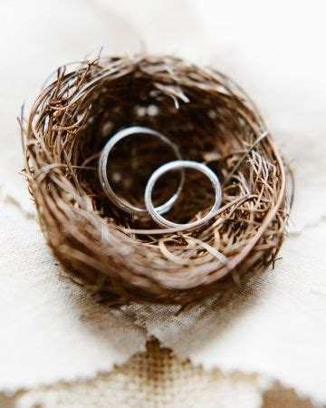 wedding bands rest in a tiny bird s nest affixed to a linen ring pillow wedding ring pillow