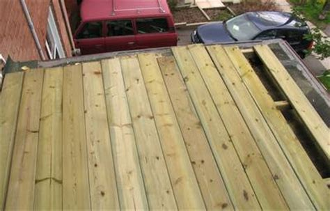Pressure Treated Deck Boards Gap by Building A Deck