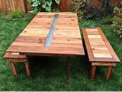 Make Outdoor Wood Table by Make A Reclaimed Wood Picnic Table With A Built In Planter TreeHugger