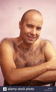 Man Facing Into Camera With Shaved Head And Hairy
