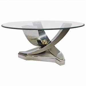 mix of polished chrome brass and brushed stainless steel With brushed steel coffee table