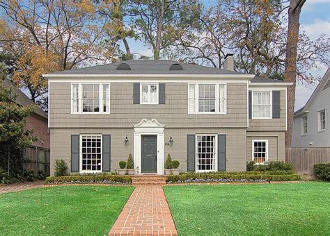 half brick half siding house i the color exterior