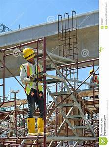 Construction Workers Working At High Level Editorial Photo