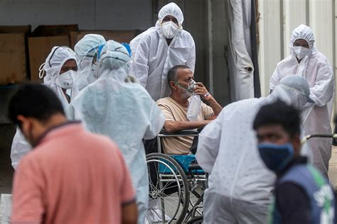 Coronavirus swamps Indian hospitals as countries promise ...