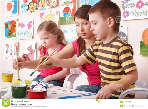 children painting with in class royalty free 331 | children painting teacher art class 14804136