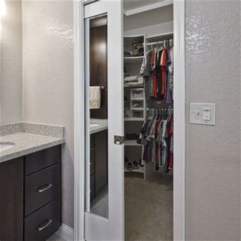 walk in closet with mirrored pocket door home