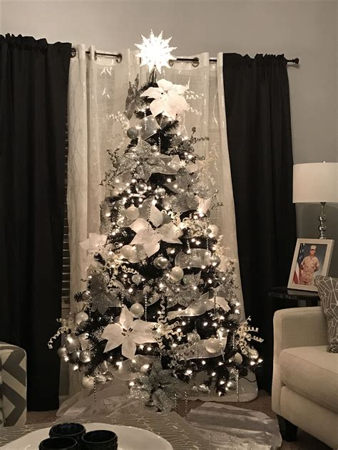 black christmas tree  silver  white decorations