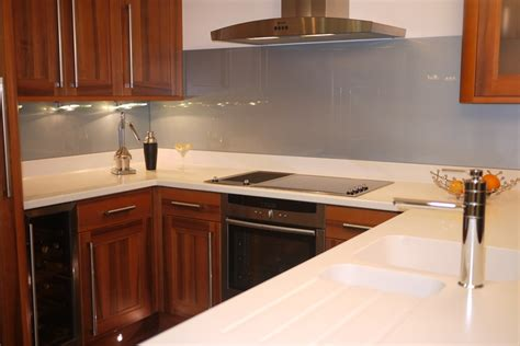 funky kitchen design ideas a silver grey glass splashback teamed up with white 3671