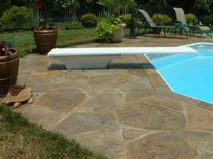 pool deck resurfaced with a sted concrete overlay