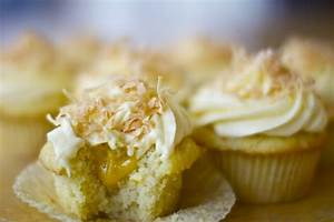 Mango-filled Coconut Cupcakes with Mango Frosting