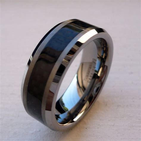 8mm Tungsten Carbide Black Carbon Fiber Men's Com Fit. Bridal Bangles. 11mm Earrings. Lotus Wedding Rings. Vintage Cartier Brooch. 52mm Watches. Crystal Bead Bracelet. Wire Bands. 14 Carat Wedding Rings