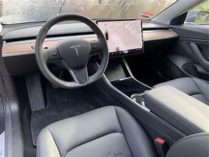 Interior Of A Tesla 3 - Lyrics Center